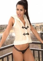 Bella Poses In Her Cute Vest - Picture 9